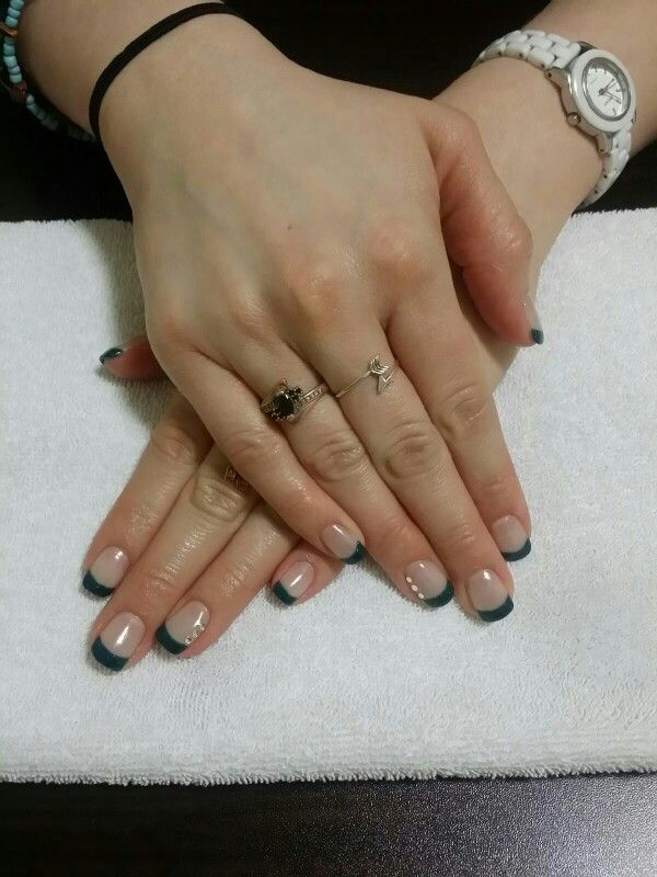 teal french manicure with 3 stones