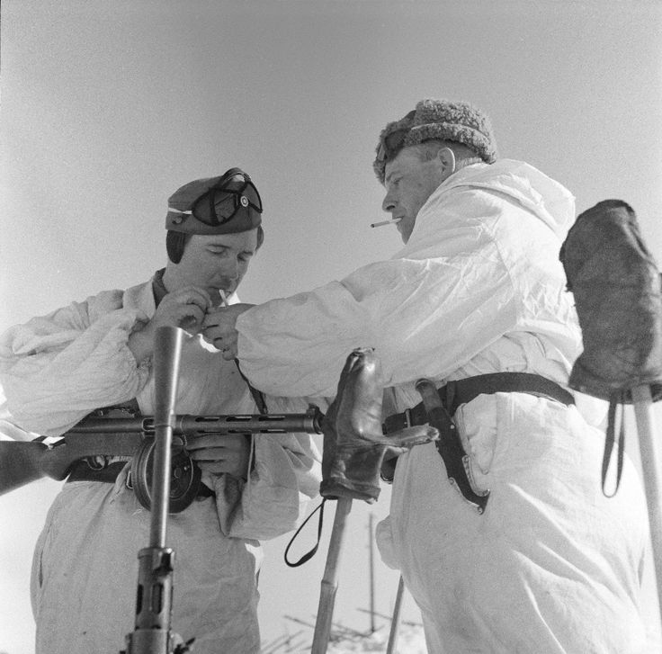 Finnish soldiers sharing a cigarette.