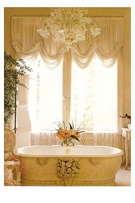 The drapes, chandelier and oh my  the tub...this is so beautiful!
