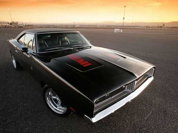 Imagine yourself prowling the streets like a dark assassin with this black 1969 Dodge Charger RT.