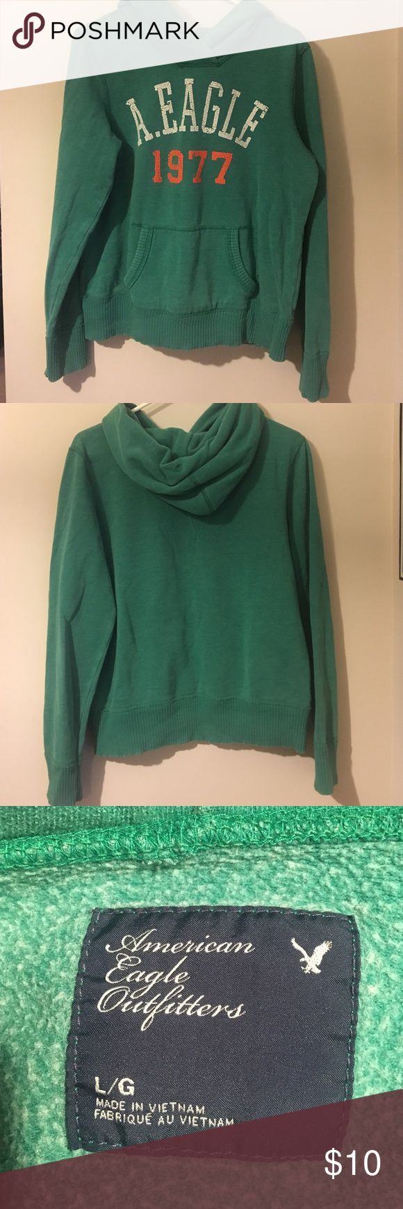 """American Eagle Outfitters Hoodie Sweatshirt Hoodie from American Eagle Outfitters, size large. Pre-loved condition but it was also made to have a """"worn"""" look. American Eagle Outfitters Tops Sweatshirts & Hoodies"""