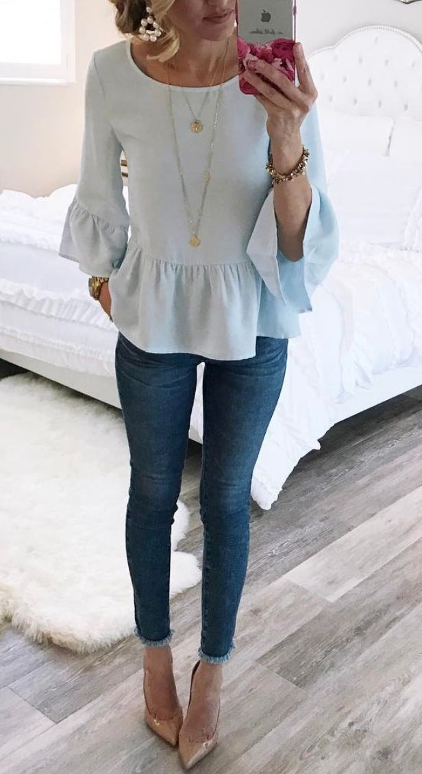 Ruffle top top with jeans and layered necklaces