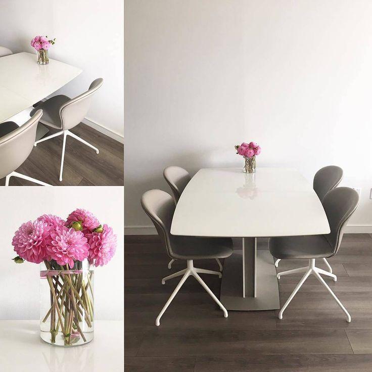 Adelaide chairs and Milano table. #BoConcept #diningroom #diningtable #diningchair #pinkflowers #danishdesign