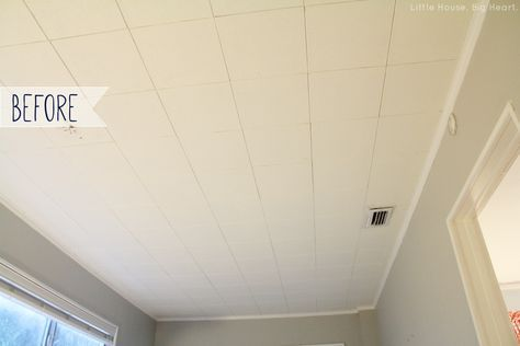 wall paper over acoustic ceiling tiles For the basement bedrooms. A million times better!