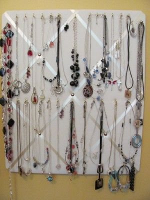 great use for the old photo collage you don't use anymore. <What a great idea! I really need to do this since I have way too much jewelry :)