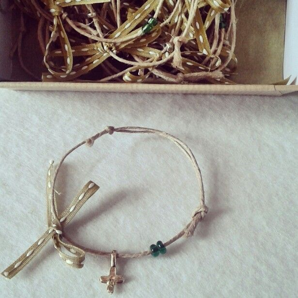 Witness bracelets in green shades for a little boys baptism ceremony