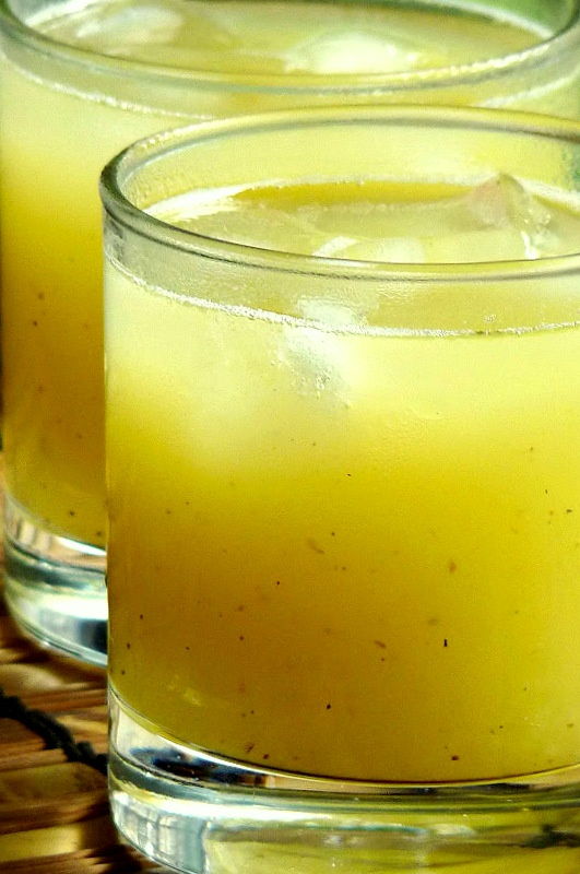Mango Ginger (detox) drink  1 Ginger Root  1 cup Frozen Mango- fresh is fine too  ice cubes  water