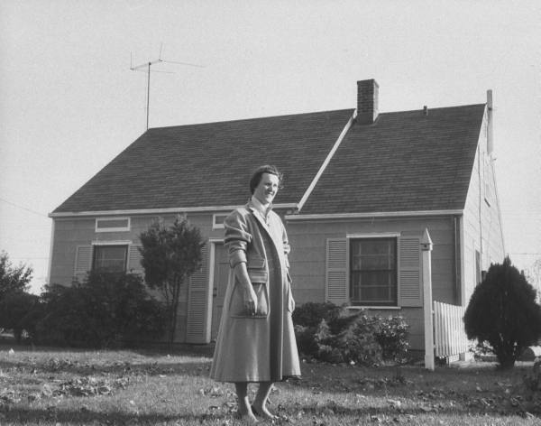 An Levittown Woman Standing In Front Of Their New Home Location Levittown Ny Us Date Taken October 1957 Photographer Joseph Scherschel