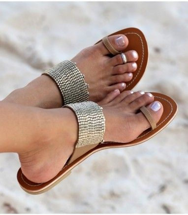 "One of Aspigas best sellers - The luna is an elegant leather sandal, with stunning metal beading and a soft leather lining, making it stylish yet comfortable. Perfect for home or holiday. Handmade in India. Genuine leather upper with white stitching. Flat leather sole with very small (0.25"") non-slip low heel."