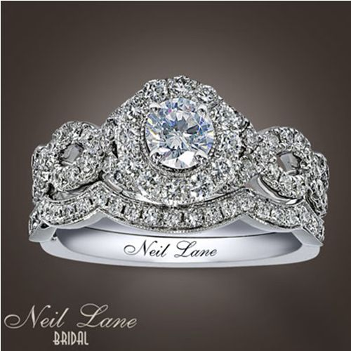 Neil Lane Engagement Ring and Wedding band...this IS my set. Modern twist to Vintage style. I LOVE my ring! BEAUTIFUL!
