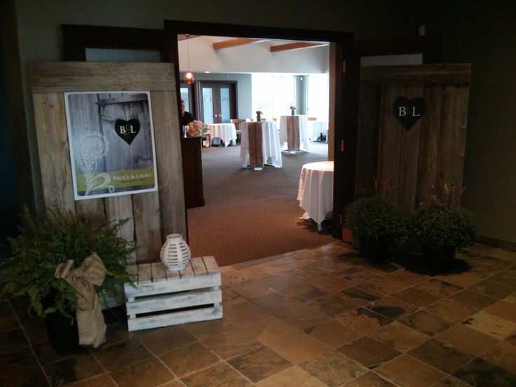 Personalized entrance with barn doors...so creative