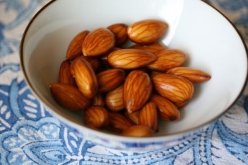 Soak almonds in water to reduce the amount of contain phytic acid in their skin, which makes digestion difficult and can rob the body of nutrients. Instructions here.