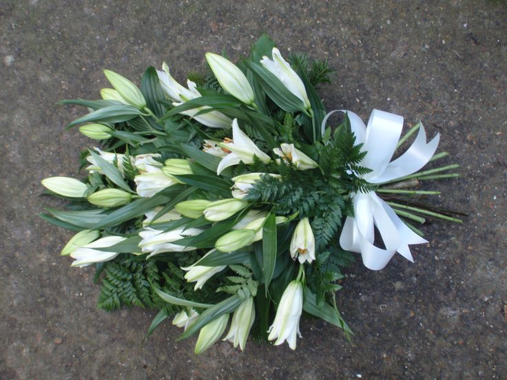 all white lily tied sheaf