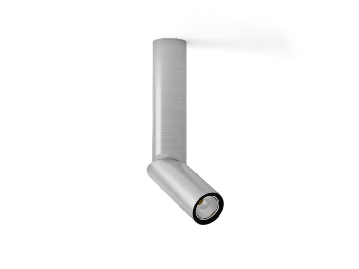 Indoor lighting fixture IP20. Aluminium extrusion manufactured. Adustable with infinite rotation system through a printed electronic circuitry that unify two bodies. Optics with different angles. Driver is included. Dali option. Finished in black and chrome and possibility to convine them.