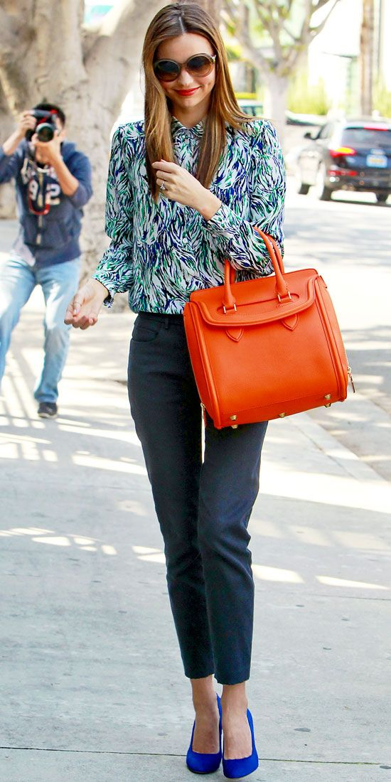 Miranda Kerr strolled L.A. in retro Stella McCartney shades, a printed blouse, cropped trousers and bright accessories.