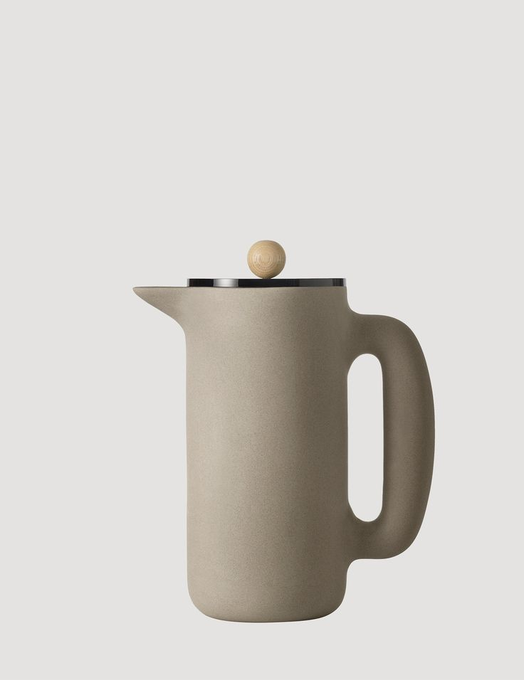 PUSH is a characteristic coffee maker with a contemporary Nordic design twist. A combination of natural materials, including a stone body and beech wood knob give PUSH a soft and pleasant touch. Designed for brewing pressed coffee, Push can also be used for tea or as a water carafe.