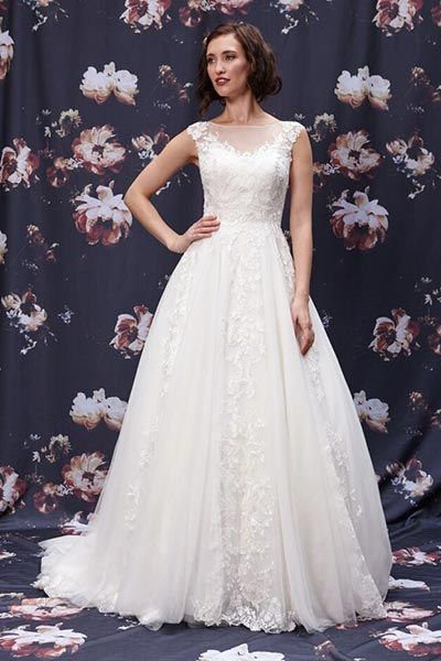 Wedding gown by Ivy & Aster.