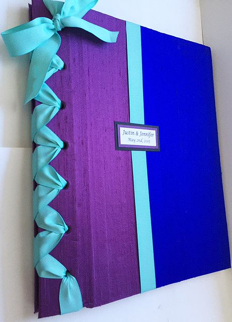 Handmade photo album to display your special event at an engagement party, bridal shower, wedding or anniversary party in clear archival photo sleeves. The book is covered indupioni silk fabric with a double faced satin ribbon to match your color scheme (photo shown above depicts wedding theme colors of purple, royal blue and mint).