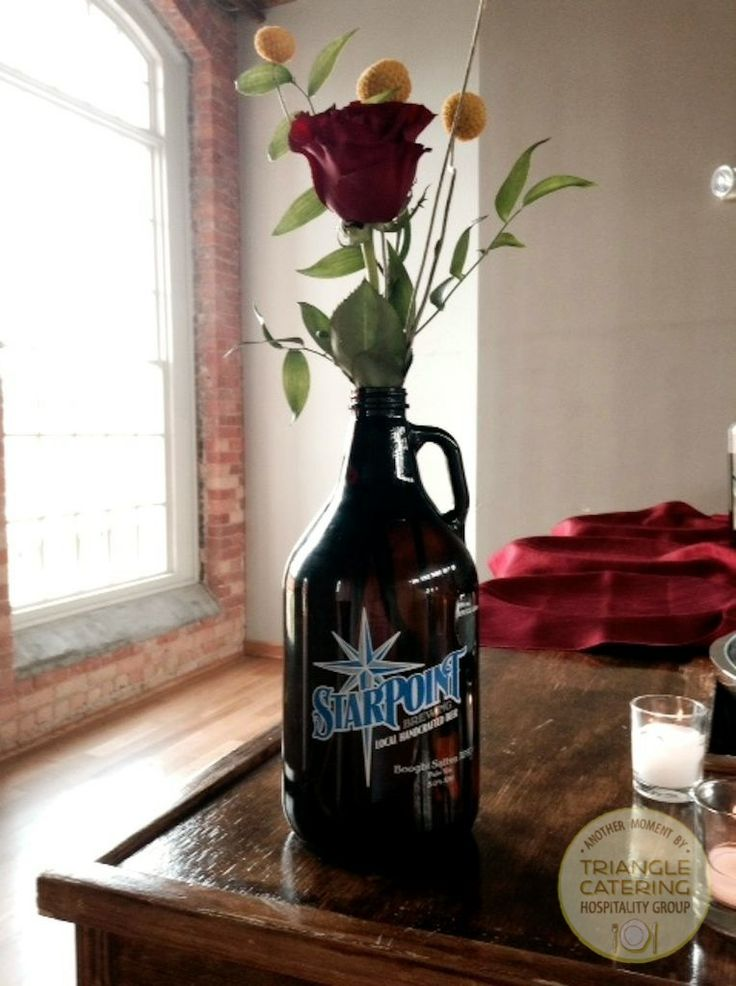 Beer growler flowers from Tre Bella make for cute wedding centerpieces at Durham wedding venue The Cotton Room #TriangleWeddings