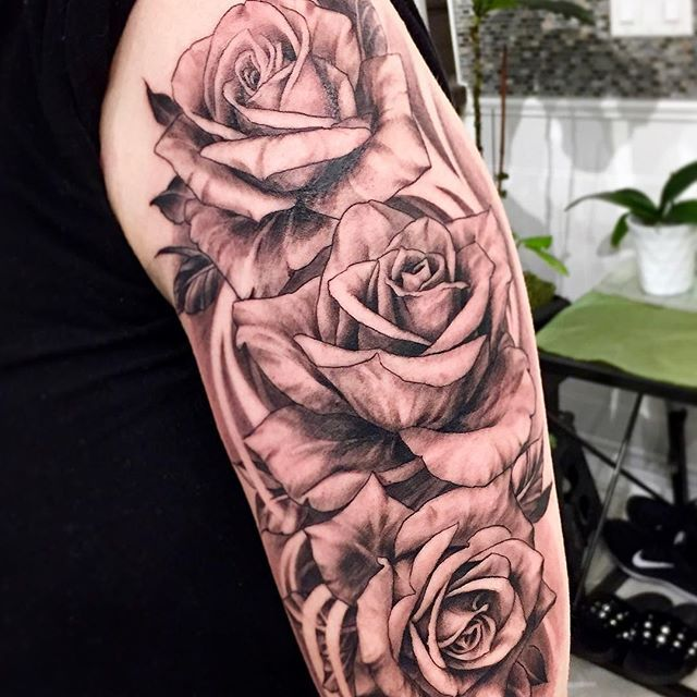 A Lovely Bunch Of Roses Done In Black And Grey Wash With Dynamic Wind Breaks To Tie It All Together Rose Tattoo B In 2020 Black And Grey Tattoos Flower Tattoo Tattoos