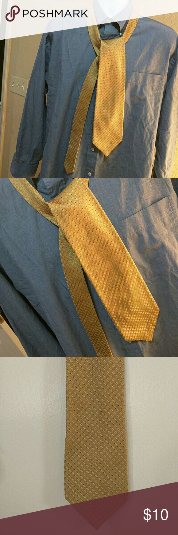 Calvin Klein Men's tie Used few times. In good condition. Color is like gold or mustard with blue. Calvin Klein Accessories Ties