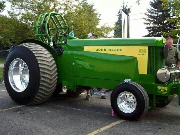John Deere 830 diesel pulling tractor. I've seen videos of this tractor pulling a sled. It's mean.