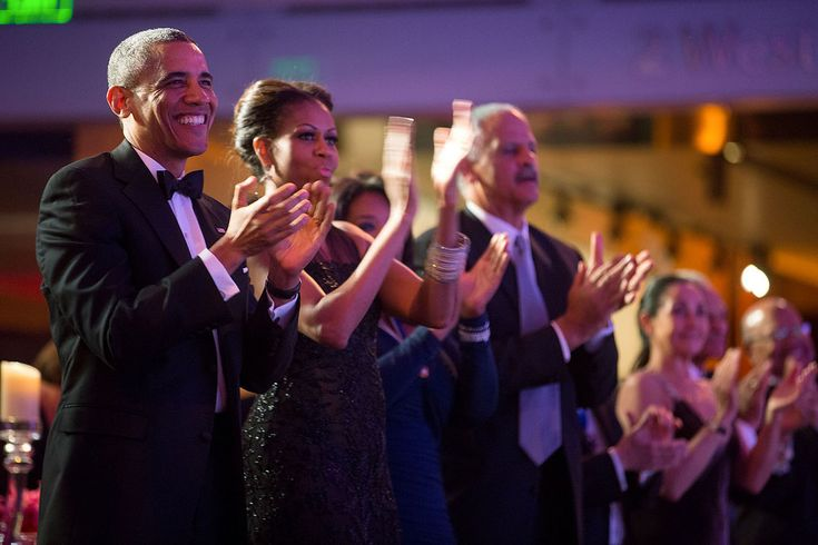 President Barack Obama, First Lady Michelle Obama, Oprah Winfrey, and Stedman Graham applaud a performance by Arturo Sandoval during a dinner honoring the 2013 Presidential Medal of Freedom awardees at the Smithsonian National Museum of American History in Washington, D.C.