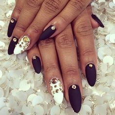 White and matte black almond nails with gold embelishments