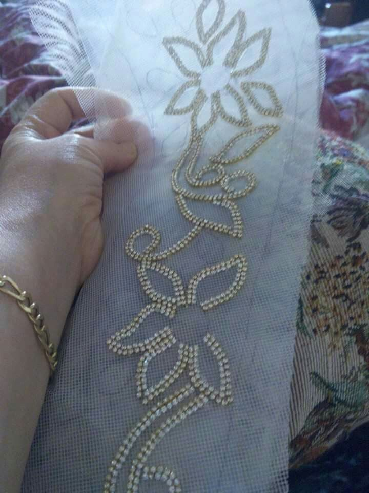 Bodice embellishment can be done directly on sheer stabilizer and then applied to bodices pieces individually