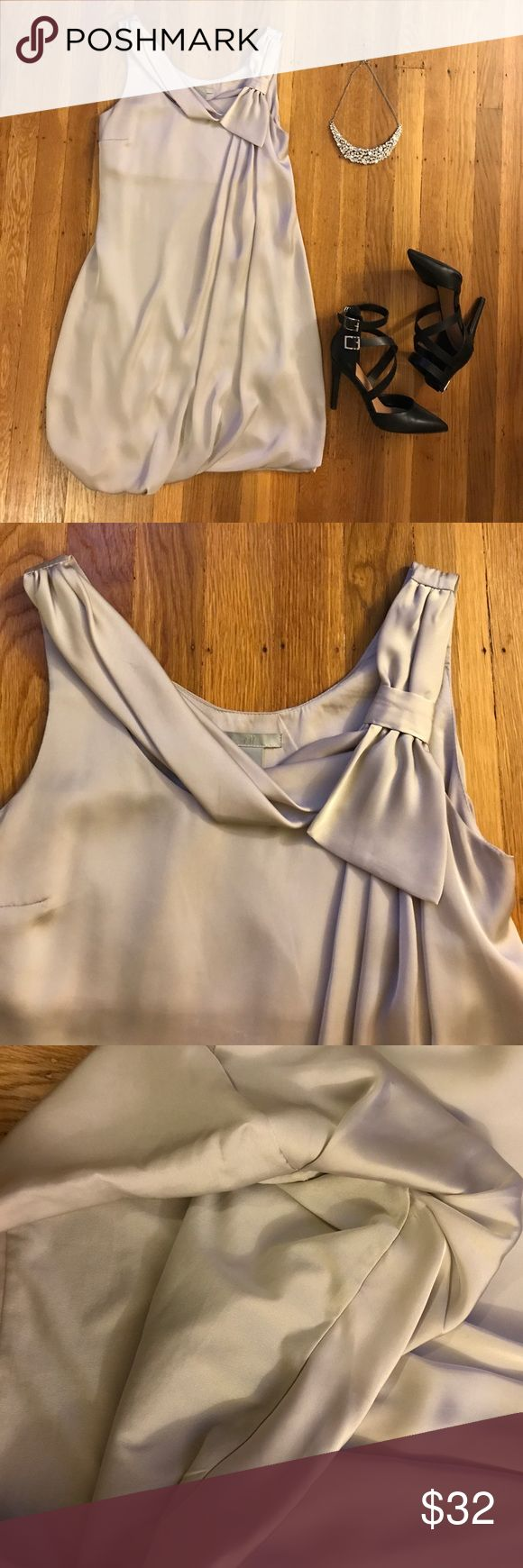 "Elegant Silver Mini Poly Dress This mini dress is super elegant. Features a ribbon-like drape design by the neckline. Waist not fitted. Material is 100% polyester. The lining is 100% polyester too. Measures approximately 31.5"" from shoulder to bottom. Worn only once! Price firm. H&M Dresses Mini"