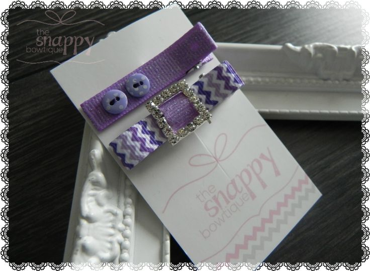 Treat your hair to this gorgeous pair of sparkly no-slip clips! The first clip, a stunning purple chevron Luxedo Bow with brilliant rhinestone center, and the second clip features tiny smokey purple polkadot buttons on shimmery lavender ribbon. Wear this set together or separate! They are the sweetest way to hold hair out of eyes!