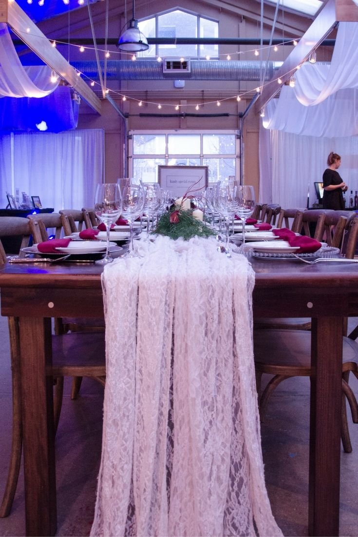 Delicate lace drapes our rustic farm tables