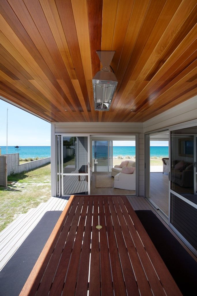 Outdoor bbq area under a covered deck off the living room at this Lockwood beach house