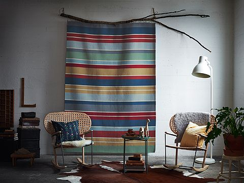 A colorful striped wool rug hung on the wall as a decoration.
