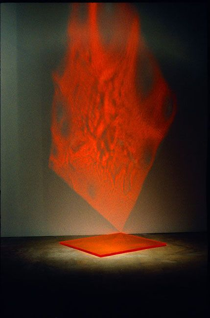 Sometimes the light is distorted as it reflects off of the fears that have formed in the darkness. This makes the protagonist fear the light initially.  The light turns red when this happens, taking on the appearance of fire or lasers.  -  Pae White - Light installation: