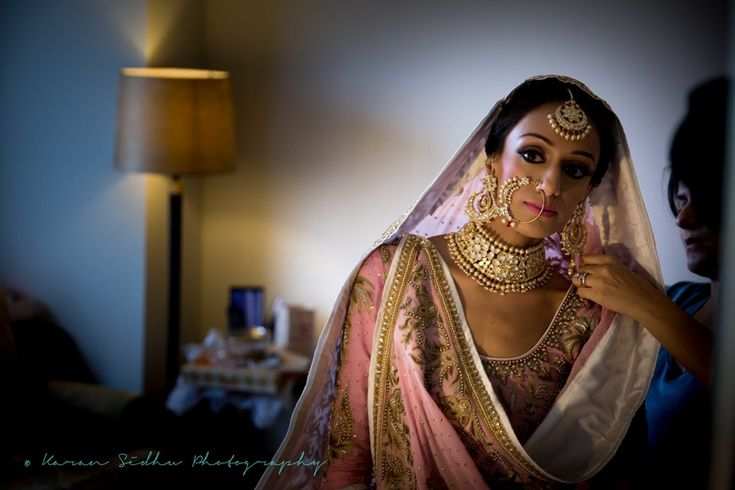 Bride - Portraits - Vintage Bridal Portrait with the Bride in Light Pink Lehenga with Golden Embroidery and a Polki Choker Necklace, Nath and Maang Tikka | WedMeGood | Picture Courtesy: Karan Sidhu Photography #wedmegood #indianbride #indianwedding #vintage #bridal