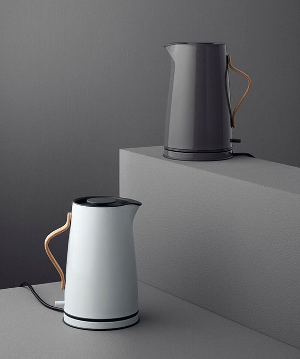 Emma electric kettle by Holmbäck Nordentoft for Stelton. 	The Emma kettle has a steel jug with an organically curved handle made of beech wood for pleasing contrast.  	The cordless jug has a dry-boil safety feature that switches off automatically when the water has boiled. Supplied with a removable limescale filter. 	Available in light blue or grey. 	Dimensions 	20w x 26d x 25cmh 	Volume: 1.2l