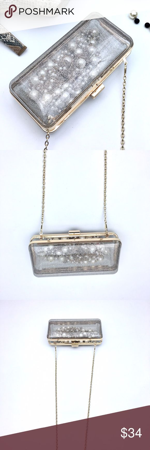 Glittery Transparent Acrylic Clutch Gold Hardware Glittery Melie Bianco Clutch with Gold Hardware. Chain can be removed. This fits an iphone 7 plus perfectly and your lipstick etc. The transparency is a cool feature. Necklace for sale too. New with tags. Melie Bianco Bags Clutches & Wristlets