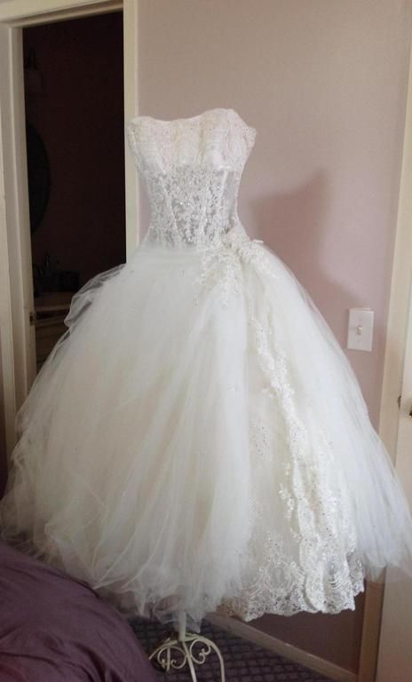 Pnina Tornai Strapless Princess ball gown in tulle 2 find it for sale on PreOwnedWeddingDresses.com