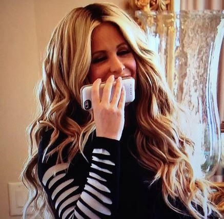 Kim Zolciak's Black & White Shredded Sleeve Sweater | Big Blonde Hair : Big Blonde Hair http://www.bigblondehair.com/real-housewives/rhoa/kim-zolciaks-black-white-shredded-sleeve-sweater/ Don't Be Tardy Fashion