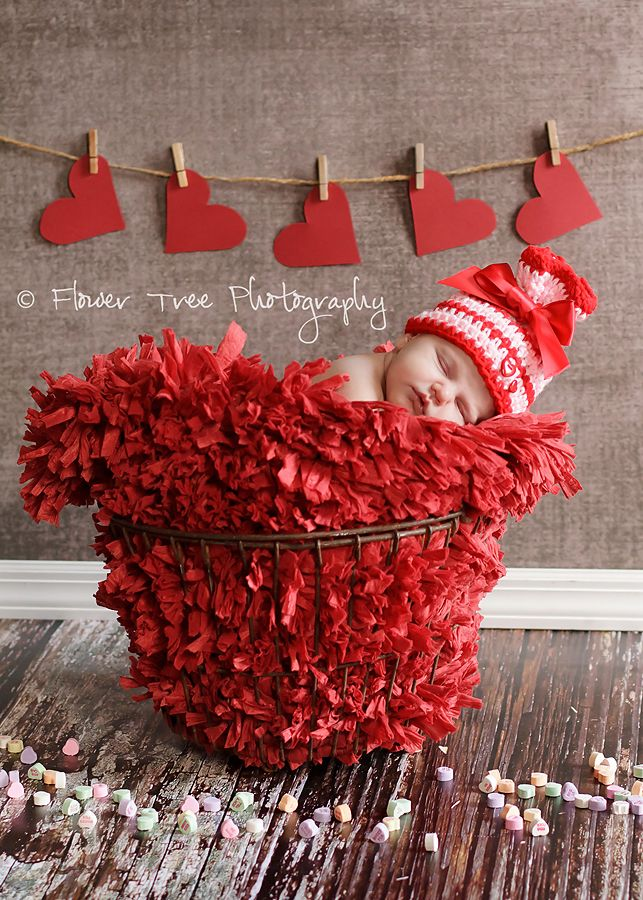 love the paper hearts on a clothesline backdrop -- very cute for a valentines day baby ;]