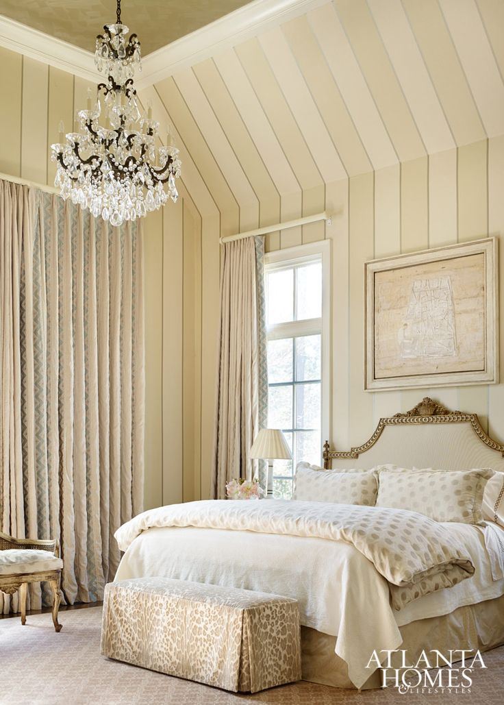 subtle patterns in the fabrics and striped walls add interest to the monochromatic color scheme in the soothing master retreat a contemporary painting by