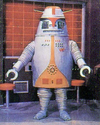 You gotta love the old school robots. Looks like in robot science we will be able to make bipedal, walking, artificially intelligent robots, but can't do better than claw hands... :P