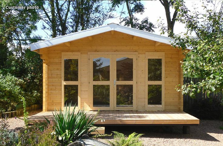 I love the simplicity of this log cabin. Raised off the ground, sitting atop gravel, surround by plants, a good sized area of decking to sit out on, and a clean crisp white roof line. Unfortunately this model is no longer available, but the Blackadder log cabin is very similar: http://www.gardenlifelogcabins.co.uk/products/florence-blackadder/product-details.php