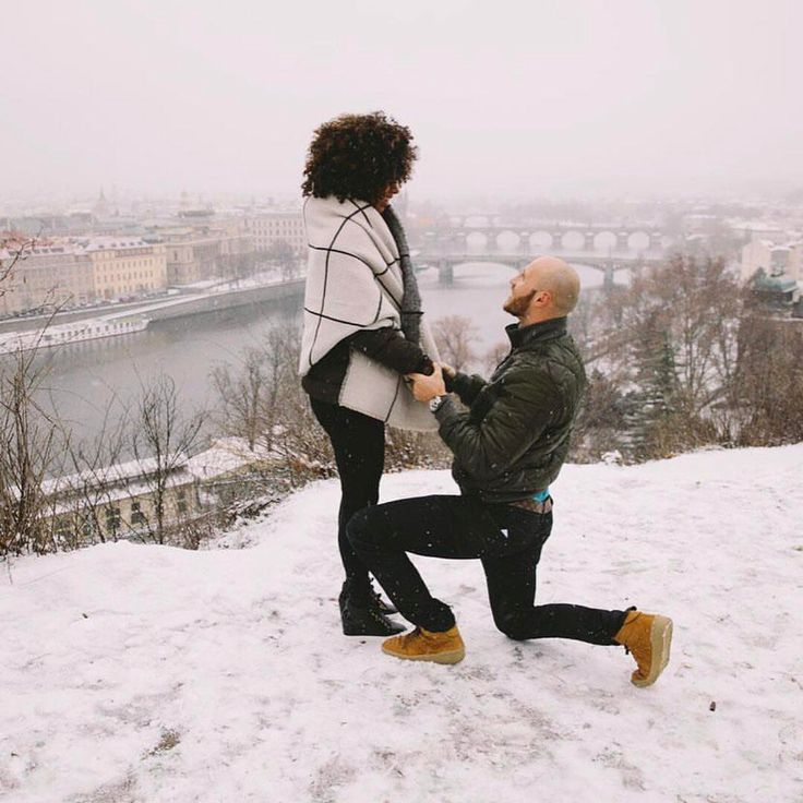 Snowy marriage proposal for this gorgeous interracial couple in Prague, Czech Republic