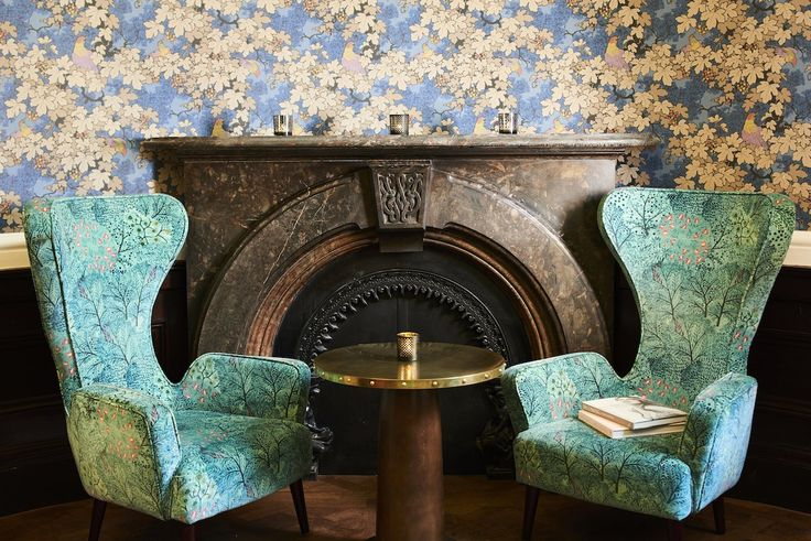 Bristol Harbour Hotel, Avon, UK. The Gold Bar with heritage fireplace and feature high back chairs. Interior architectural design by DO Design Studio Ltd.
