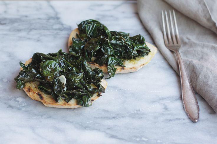 Kale, garlic, lemon, and oil -- piled high on crostini.