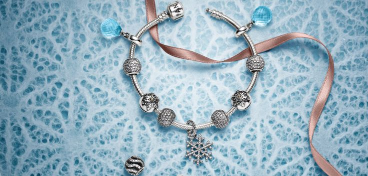 Ice blue colours and sparkling snowflakes capture the cool spirit of winter. Celebrate the season with a touch of ice blue magic. #PANDORA #PANDORAbracelet #ChristmasCollection