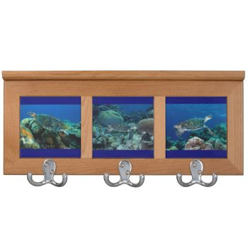 A cool coat racks featuring a trio of prints of the many sea turtles found on Australia's Great Barrier Reef #reef #ocean #turtle #coral #tropical #sea #turtle #coral #reef #coral #sea #coat #rack #sea #turtle #coat #rack