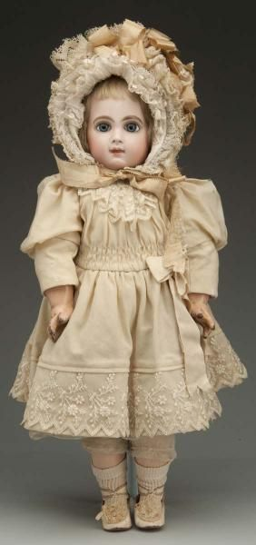 Antique doll preserved with loving care ...